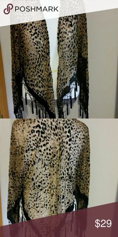 Open front poncho Everyone looks good in leopard! Open front poncho trimmed with velvet and beaded tassels. Other