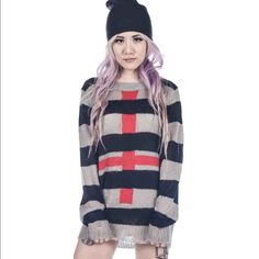 UNIF Cross Sweater Cute distressed sweater. Worn a few times but in good condition :-) UNIF Sweaters