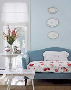 Really like the floral on the couch along with the contrasting blues.