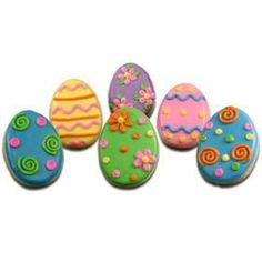 CUTE EASTER EGGS! USE ROYAL ICING AND THE BAG WITH THE TIPS. OUTLINE COOKIE WITH ICING AND THEN FILL IN COOKIE WITH ICING AND DECORATE WITH TIPS.