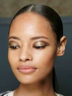 Jason Wu - metallic gold and brown eyeshadow for a rich, festive makeup look | allure.com