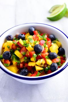 This Mango Blueberry Salsa makes a fresh fruit salsa recipe perfect for serving with fish, chicken, or on a chip! I love fruit salsa recipes! I think they are perfect pared with grilled fish or chicken, but have to admit that I also love just digging into a bowl of it with a chip on occasion!...