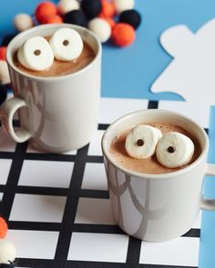 Cute and spooky marshmallow eyeball hot chocolate. Stare your food right in the eyes! This is a great idea to add to your list of ideas for a halloween party for kids! Nonalcoholic drinks like this are fun, festive, and easy to make!