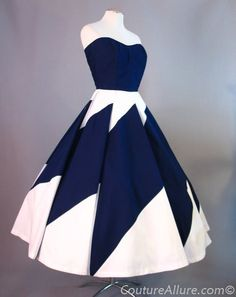 1950's - Renee Marciel was a Miami based designer who was born in France. She had a wonderful sense of style and designed and wore what she liked, not what fashion dictated. Her pieces are exceedingly rare and highly collectible today. This dress is fashioned of cotton broadcloth in navy blue and white. The full skirt forms almost a complete circle when laid flat. Skirt is seamed and pieced from trapezoid shaped pieces of cotton that are expertly sewn together to make the pattern in the…