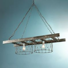 Rustic Ladder Island Chandelier Rustic chain and wire baskets create this farm house inspired island chandelier. The wood ladder has a slight white wash for an old barn wood patina look Hanging Ladder, Old Ladder, Rustic Ladder, Ladder Decor, Antique Ladder, Wooden Ladder, Antique Lamps, Rustic Chandelier, Chandelier Shades