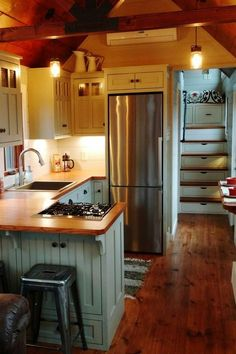 Tiny House Living: Inside the 352-square-foot farmhouse is a bedroom ...