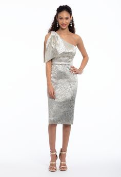 With wedding season approaching, what better way to get excited than by shopping for the perfect wedding guest dress?! This classic silhouette in chic metallic is perfect for stepping up your style game: featuring a one shoulder neckline, fitted bodice and sheath silhouette, this knee-length evening dress is modest yet undeniably trendy. Accessorize with high heel multi strap sandals and a satin glitter frame clutch. #CamilleLaVie