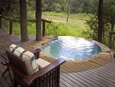 This blissfully quiet retreat enjoys shade and peace beneath a leafy canopy of ebony trees. As one of only 12 guests, you feel instantly at home in this luxurious lodge, where classic interiors enfold guests in quiet style and elegance. Generous private plunge pools and shady decks look out onto the dry riverbed just metres away. Dine under the ancient jackalberry tree where skilled chefs serve delicious meals or steal away for an intimate dinner in the well-stocked wine cellar.