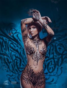 Talented 'calligraffiti' artist Pokras Lampas, from St. Petersburg, Russia, has his models strip naked before he scribbles his calligraphy freehand on their chests, navels and legs. The intricate designs wind around the models' bodies, covering them in the ancient writing form in a variety of colour