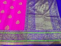 Deep Fuchsia banaras dupion silk saree with bright blue zari border and all over zari butties with antiq gold zari