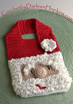 Baby will love his or her Santa Bib! Ho Ho Ho! With a fun, furry beard and smiling eyes, this Santa Bib makes a perfect gift for baby's first Christmas.