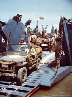 Trucks and jeeps which will carry men and supplies to the front lines of the invasion are loaded onto an American Landing Craft in a British Harbor. Jeep Willys, Jeep Wrangler Tj, Jeep Cj, Military Jeep, Military Vehicles, Military Uniforms, D Day Normandy, Panther, Landing Craft