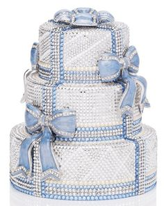Judith Lieber Limited Edition Crystal Cake Minaudiere, $6,995.00; impractical, extremely expensive, but kind of cool!