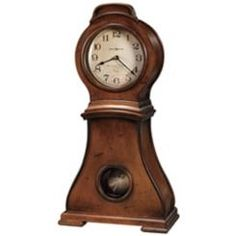 Im addicted to clocks. love this mantle clock by Ty Pennington