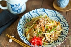 Delicious Japanese yaki udon noodle dish with cabbage, onion, pork, shiitake mushrooms, and udon noodles stir fried, flavored with mentsuyu and soy sauce.