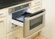 The drawer-style configuration of Sharp's 1,000-watt microwave eliminates stretching to reach the food inside. $899