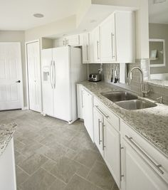 white cabinets, gray subway tile, kashmir white granite - my kitchen inspiration except with dark wood floors