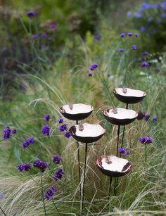 These steel poppies sway in the breeze and collect rainwater for butterflies or can be filled with a scattering of birdseed. Four different colors, Set of 5 $ 29.95