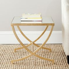 Features:  Shape: -Rectangle.  Design: -Table.  Style: -Modern.  Top Finish: -Mirror.  Base Material: -Metal.  Top Material: -Mirrored.  Base Type: -X/Cross Legs.  Base Finish: -Gold.  Hardware Finish