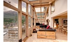 Zermatt's internationally acclaimed architect, Heinz Julen, designed this extraordinary double-level 260m2 penthouse. With concepts such as a fireplace nesting in the middle of the living-room window, and original hand-made furniture.