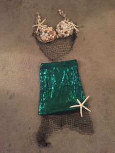 DIY Mermaid Costume Sequin skirt from H&M, an old bra, lots of sea shells, some fishing net, and a hot glue gun