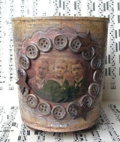 altered tin with buttons...