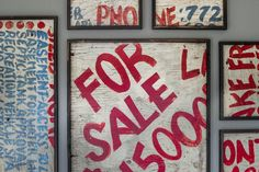 Found in the original home, an old for sale sign was cut up, set in burned wood frames and mounted in the family room for an artistic nod to the home when it was first purchased.