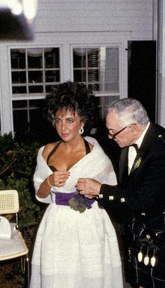 Elizabeth Taylor with Malcolm Forbes, 1987.