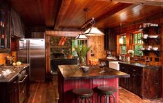 Rustic red kitchen- lovely cabin kitchen