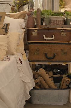 Stacked vintage suitcases, always perfect accents for a farmhouse or cottage!