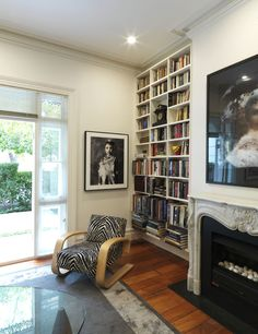 WOOLLAHRA TERRACE | alwill  #woodenfloor #interiors #livingroom #artwork #fireplace #bookcase #bookshelf #armchair