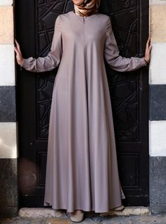 Easy Care Flared Abaya Acorn color asked for it, and we are happy to oblige: Fin. Muslim Women Fashion, Modern Hijab Fashion, Abaya Fashion, Muslim Dress, Hijab Dress, Stylish Dress Designs, Stylish Dresses, African Fashion Dresses, Fashion Outfits