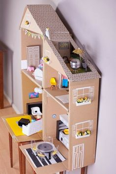 Cardboard Dollhouse DIY with rooftop garden. Look at all the photos, backward and forward to see how clever she was with her use of everyday items to furnish and decorate.