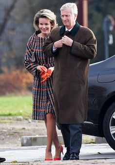 Wrapping up: The royal couple kept warm in long coats as they carried out their engagement...