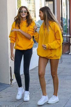 Teenage beauty: Even in a simple yellow hoodie and fitted skinny jeans the pretty teenager stood out, matching outfits with her gal pal