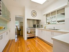 Light kitchen with wooden floors