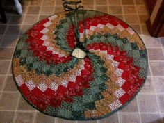 Here you see a gift I just finished this morning for my daughter. It is a spiral bargello style quilted tree skirt. I sewed on it all...