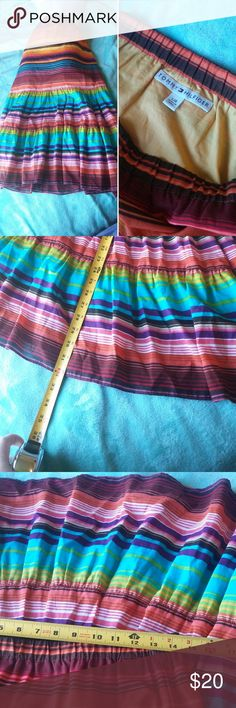 """TOMMY HILFIGER HIGH WAIST MAXI BOHO SKIRT LARGE BEAUTIFUL TOMMY HILFIGER HIGH WAISTED MAXI SKIRT BOHO LOOK GREAT FOR FESTIVAL SEASON WHICH IS RIGHT ABOUT TO START!!! LENGTH IS 32"""" WAIST IS 15"""" VERY FLOWY HAS A CLOTH SLIP UNDERNEATH THAT ENDS A LITTLE PAST KNEE. GENTLY USED GOOD CONDITION NO KNOWN FLAWS Tommy Hilfiger Skirts Maxi"""