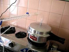 Home distillation equipment assembled to a pressure cooker.The glass condenser is available in all scientific equipment shops . Home Distilling, Home Instead, Making Essential Oils, How To Make Oil, Health Shop, Star Wars Art, Home Brewing, Bourbon, Alcohol