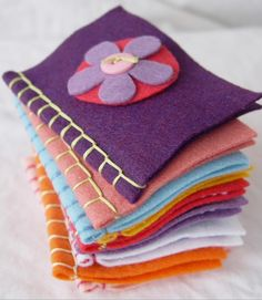 felt book... I can see this being a super cute but also pretty time consuming project in the classroom, have kids decorate insides and select cover image, I'd take them home and sew seam and sew on cover image if it requires sewing then being back to class and let kids take home for gifts for a family member or friend. Worth considering!
