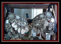 Mirror and Metal Coin Bra  Ornately embellished metal worked mirrors with foreign and antique coins, full coverage- guaranteed elegance. order by cup size. Save! Was $210-$250    A-cup: $180.00      B-cup: $190.00  C-cup: $210.00      D-cup: $220.00