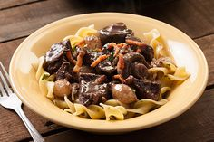 This classic French beef stew recipe from Tyler Florence has braised beef, mushrooms, and pearl onions in a rich red wine sauce. French Beef Stew Recipe, Beef Recipes, Cooking Recipes, Yummy Recipes, Chicken Recipes, Recipies, Dinner Recipes, Classic French Dishes, Kitchens