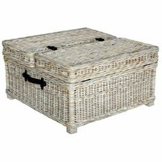 "Trunk-style wicker coffee table with a whitewashed finish and interior storage.  Product: Coffee table    Construction Material: Wicker and metal    Color: Whitewash   Features: Lift-lid storageDimensions: 18"" H x 31"" W x 31"" D"