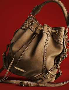 A relaxed suede bag with brogue detailing from the Burberry A/W13 accessories collection