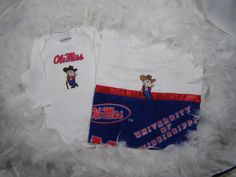 "The University of Mississippi ""Ole Miss"" 2 Piece Baby/Shower Gift Set includes Onesie & Burpee for Babies by FairyTale Frocks. $35.00, via Etsy."