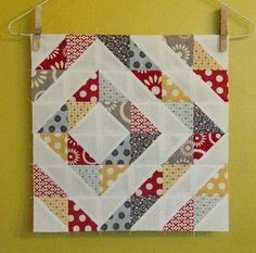 off center half square triangles quilt block