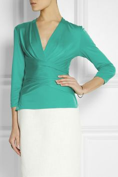 Wrap-effect silk-jersey top. Feminine silhouette and soft fabric.