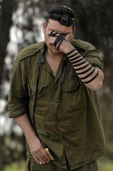 "IDF soldier prays ~ ""And thou shalt bind them for a sign upon thine hand, and they shall be as frontlets between thine eyes. And thou shalt write them upon the posts of thy house, and on thy gates."" Deut 6:8-9"