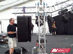 The AV Direct technical team carefully preparing stage set up with audio equipment. Stage Design, Set Design, Stage Set, Audio Equipment, Event Management, Staging, Speakers, How To Find Out, Outdoor