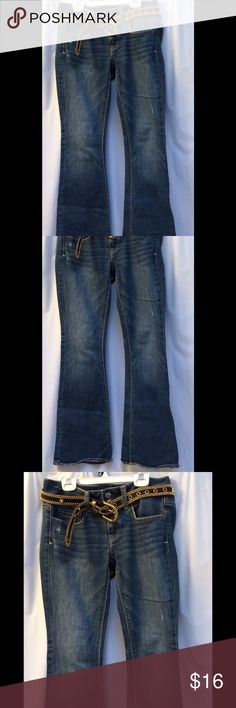 "AE Artist Sz 2/Short Med Bluejeans Size 2 Artist, Lowrise, boot cut, med blue jeans feature front zipper and two button closure  BOOTY pops if u have lil' butt (c 2nd pic) 5- pocket jeans have 2 front pockets with a change pocket, and 2 back pockets  belt loops/ Belt is for sale but not included;)  khaki stitching detail makes these jeans rock 25.5"" Waist  29.5"" Inseam American Eagle Outfitters Jeans Boot Cut"